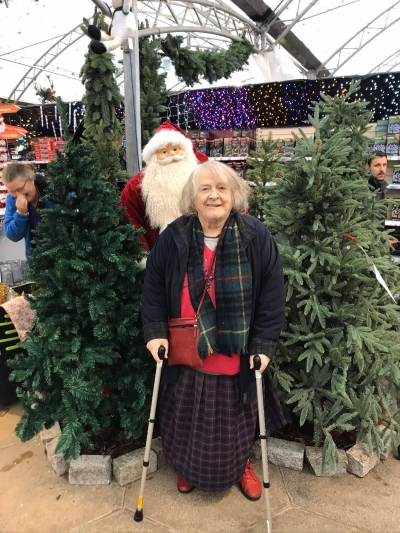 A home care client enjoys a trip to the shops for Christmas Shopping. Coast Home Care Service.