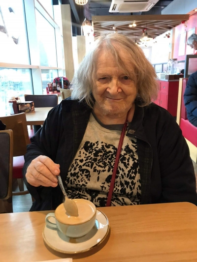 A home care client enjoys a trip to the shops for Christmas Shopping and a cup of coffee and cake. Coast Home Care Service.