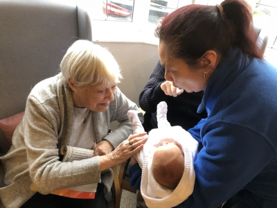 Baby Pearl Poore visits the residents at Whitebriars residential care home, Bexhill on Sea, Sussex.