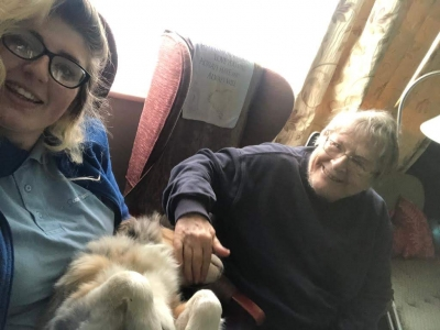 Home Care Client Sheila loves visits from her carer Jess, especially when she brings her dog Kovu. Coast Home Care, St Leonards on Sea, Hastings, Sussex.