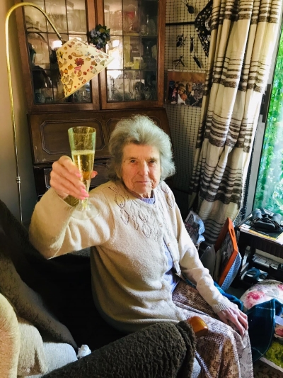 Our home care client celebrates her birthday with her carer in a birthday afternoon tea. Home Care Bexhill, St Leonards, Hastings, Eastbourne, Battle, East Sussex