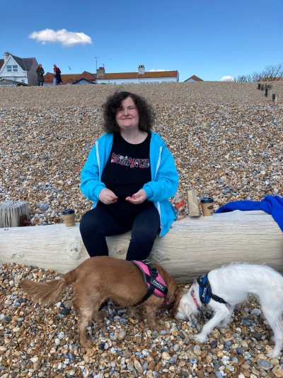 Service user enjoys a trip to the beach with her carers dogs. Coast Community Care, Bexhill East Sussex