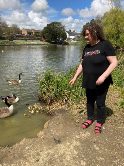 Service user enjoys a trip to the park to feed the ducks. Coast Community Care, Bexhill East Sussex