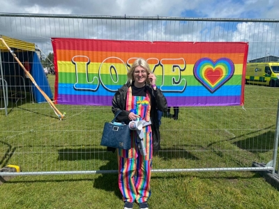 Service user enjoys a day with her support worker at Easbourne's Gay Pride. Eastbourne Sussex.